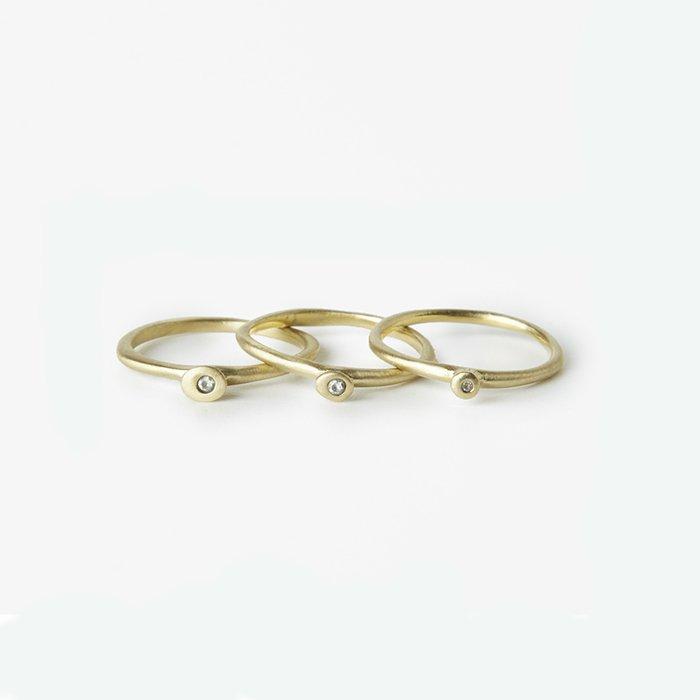 Giuliatamburini -  Tao Bronzo giallo e zircone bianco